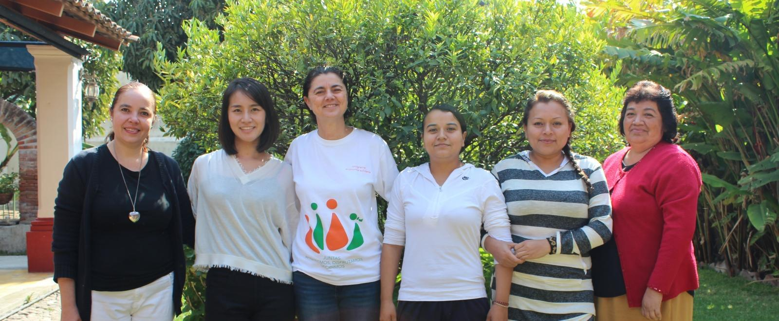 International Development interns pose outside with staff from a women's empowerment organisation in Mexico.